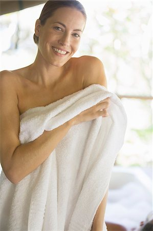 Woman toweling off in spa